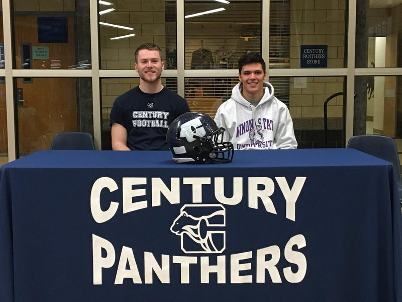 Rochester Century football players Carter Jensen (left) and Jose Benjamin (right) pose for a photo on National Signing Day