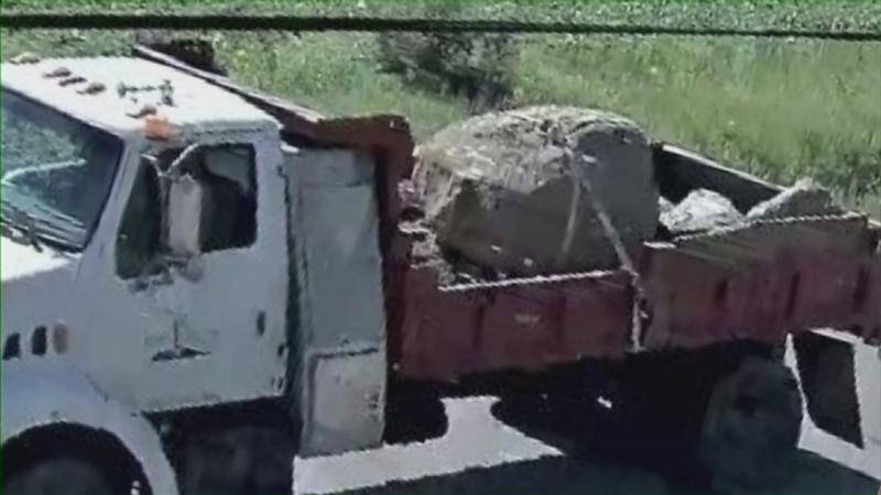 Boulder Falls Off Truck, Kills Two