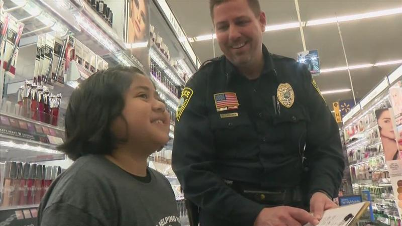 Cops and Children Go Shopping for Families in our Area