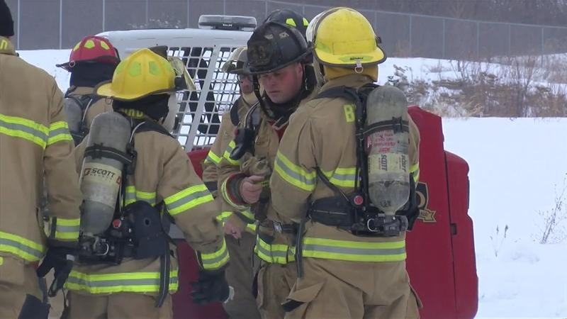 High school students experience first-hand what it's like to be a firefighter