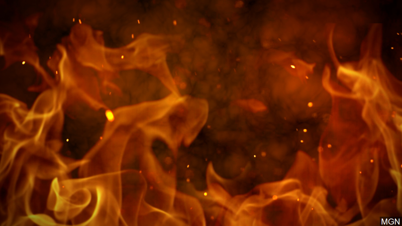 Firefighters battling flames inside house find a body