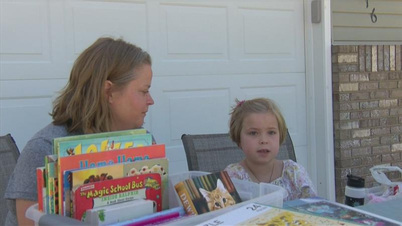 8-year-old girl donates garage sale funds to charity