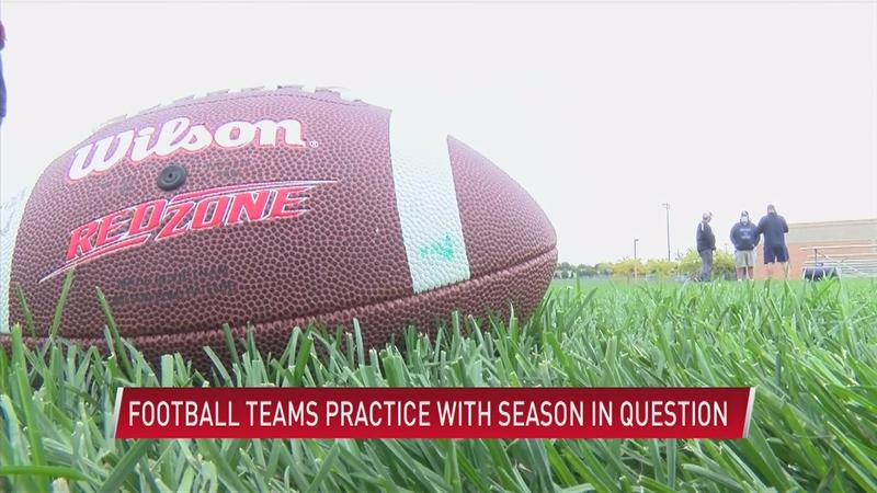 Football teams practice with season in question