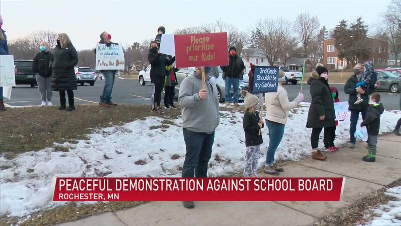 Handful of families hold peaceful demonstration against RPS board