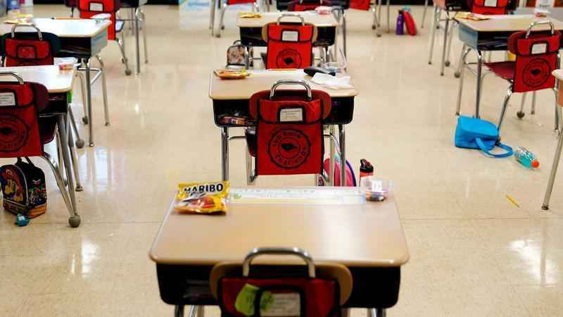Photo: AP Photo/Matt Slocum, File. In this Thursday, March 11, 2021 file photo, desks are arranged in a classroom at an elementary school in Nesquehoning, Pa. In the fall of 2021, vaccinated teachers and students should no longer wear masks inside school buildings and no one need bother with them outside, the Centers for Disease Control and Prevention said Friday, July 9, 2021, in relaxing its COVID-19 guidelines.