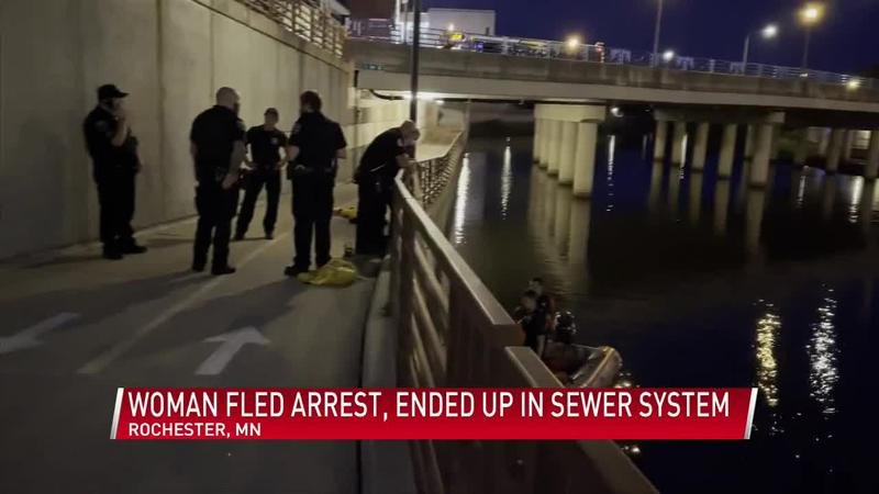 UPDATE: Woman rescued from storm drain after fleeing arrest