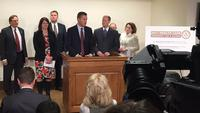 House Speaker Kurt Daudt, center, and other Republican lawmakers announce plans to address health insurance costs Thursday.