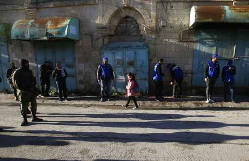 In Hebron, Palestinians patrol in place of foreign monitors