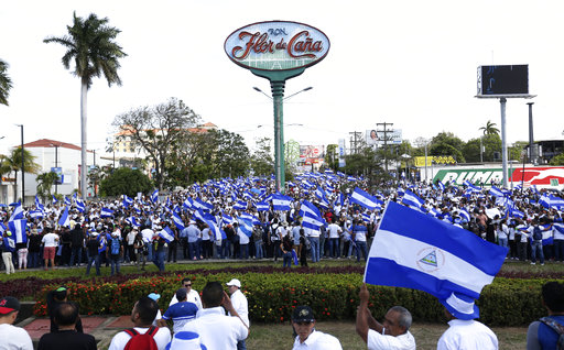 Thousands protest against Nicaragua government, urge calm
