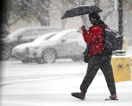 East Coast commuters face slow rides to work after snowstorm
