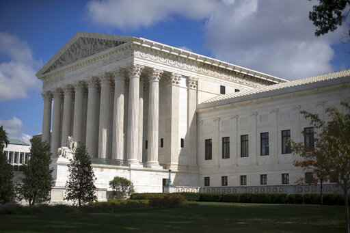 FILE - In this Oct. 5, 2015 file photo, the Supreme Court is seen in Washington. The Supreme Court is letting the lawsuit against the maker of the rifle used in the Sandy Hook Elementary School shooting go forward. The justices on Tuesday are rejecting an appeal from Remington Arms that argued a 2005 federal law shields firearms manufacturers from liability in most cases when their products are used in crimes. (AP Photo/Carolyn Kaster, File)