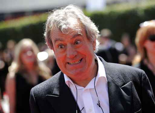 FILE - In this Saturday, Aug. 21, 2010 file photo, Terry Jones arrives at the Creative Arts Emmy Awards in Los Angeles. Terry Jones, a member of the Monty Python comedy troupe, has died at 77. Jones's agent says he died Tuesday Jan. 21, 2020. In a statement, his family said he died