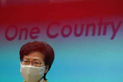 Hong Kong Chief Executive Carrie Lam listens to reporters' questions during a press conference in Hong Kong, Tuesday, June 2, 2020. Lam hit out at the