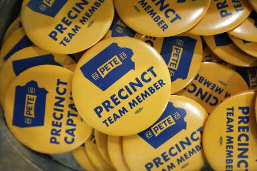 FILE - In this Jan. 9, 2020, file photo, precinct team member buttons are seen during a caucus training meeting at the local headquarters for Democratic presidential candidate former South Bend, Ind., Mayor Pete Buttigieg, in Ottumwa, Iowa. (AP Photo/Charlie Neibergall)