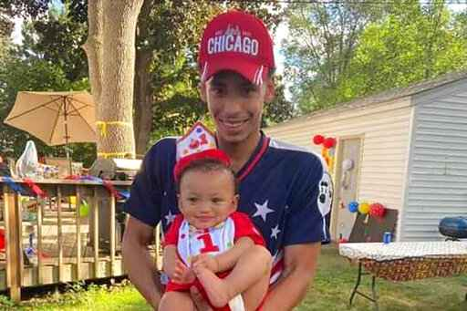 FILE - This photo provided by Ben Crump Law, PLLC. shows Daunte Wright and his son, Daunte Jr., at his first birthday party. Wright, 20, was killed during a traffic stop by�a white suburban Minneapolis police officer on Sunday, April 11, 2021. (Ben Crump Law, PLLC. via AP)