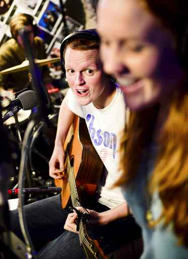 FILE - In this Dec. 3, 2012 file photo, Zach Sobiech, left, plays guitar as his friend Samantha