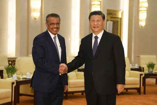 FILE - In this Jan. 28, 2020, file photo, Tedros Adhanom, director general of the World Health Organization, left, shakes hands with Chinese President Xi Jinping before a meeting at the Great Hall of the People in Beijing. Throughout January, the World Health Organization publicly praised China for what it called a speedy response to the new coronavirus. It repeatedly thanked the Chinese government for sharing the genetic map of the virus