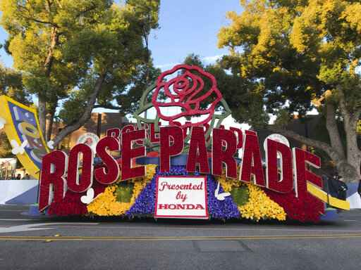 FILE - In this Jan. 1, 2020, file photo a 2020 Rose Parade float is seen at the start of the route at the 131st Rose Parade in Pasadena, Calif. The 2021 Rose Parade is canceled because of the coronavirus pandemic, but viewers will still get a show with a two-hour television special on New Year's Day, organizers said. The Tournament of Roses Association said in a Thursday, Oct. 29, 2020, news release that the TV special will include