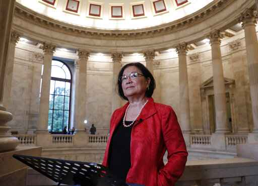 FILE - This Sept. 25, 2018 file photo shows Sen. Mazie Hirono, D-Hawaii, at Capitol Hill in Washington.  Hirono, the Senate�s first Asian-American woman and only current immigrant, is working on a memoir. Viking announced Tuesday that the book, currently untitled, will come out in 2021. Hirono, 72, will write about emigrating at age 8 to the United States after her mother fled an abusive marriage in Japan. (AP Photo/J. Scott Applewhite, File)