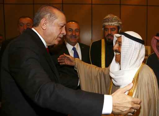 FILE - In this Wednesday, Dec. 13, 2017 file photo, Turkey's President Recep Tayyip Erdogan, left, welcomes Kuwait's Emir Sheikh Sabah Al Ahmad Al Sabah, prior to the opening session of the Organisation of Islamic Cooperation Extraordinary Summit in Istanbul. Kuwait state television said Tuesday, Sept. 29, 2020, the country's 91-year-old ruler, Sheikh Sabah Al Ahmad Al Sabah, had died. (Kayhan Ozer/Pool Photo via AP, File)