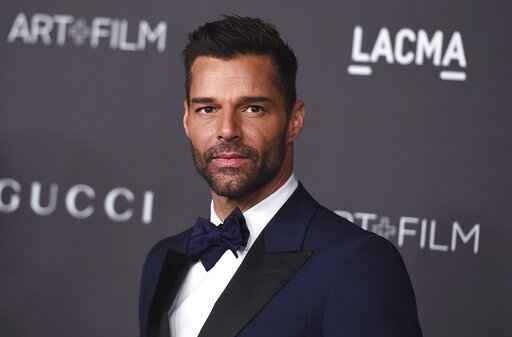 FILE - This Nov. 2, 2019 file photo shows Ricky Martin at the 2019 LACMA Art and Film Gala in Los Angeles. Martin will perform his latest song �C�ntalo� with Residente and Bad Bunny at the Latin Grammy Awards on Thursday, Nov., 14, and will also serve as master of ceremonies along actresses Roselyn S�nchez and Paz Vega. (Photo by Jordan Strauss/Invision/AP, File)