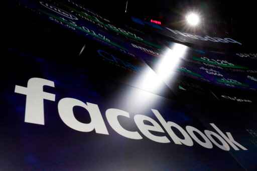 FILE - In this March 29, 2018, file photo the logo for Facebook appears on screens at the Nasdaq MarketSite in New York's Times Square. Facebook made it through the 2020 election cracking down political misinformation with a few tweaks to its rules and stepped-up enforcement. While many of the changes were supposed to be temporary, emergency measures, it is becoming increasingly clear that there is no returning to the Facebook of the past. (AP Photo/Richard Drew, File)