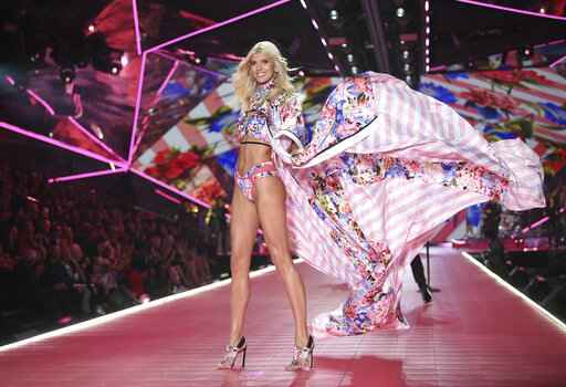 FILE- In this Nov. 8, 2018, file photo model Devon Windsor walks the runway during the 2018 Victoria's Secret Fashion Show at Pier 94 in New York. Victoria's Secret's owner, L Brands, said that the private-equity firm Sycamore Brands will buy 55% of Victoria's Secret for about $525 million. Victoria's Secret will become a private company. (Photo by Evan Agostini/Invision/AP, File)
