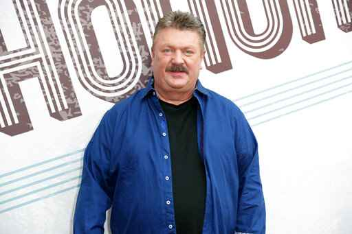 FILE - This Aug. 22, 2018 file photo shows Joe Diffie at the 12th annual ACM Honors in Nashville, Tenn. A publicist for Diffie says the country singer has tested positive for COVID-19. Diffie is under the care of medical professionals and is receiving treatment. (Photo by Al Wagner/Invision/AP, File)
