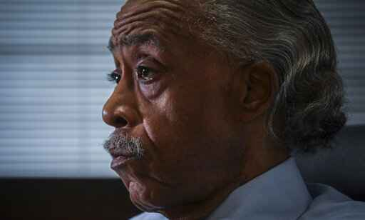 The Rev. Al Sharpton listens during an interview at his office, Thursday, July 30, 2020, in New York. For more than three decades, Sharpton, 65, has been an advocate for Black American families seeking justice in the wake of violence that highlight systemic racism. (AP Photo/Bebeto Matthews)