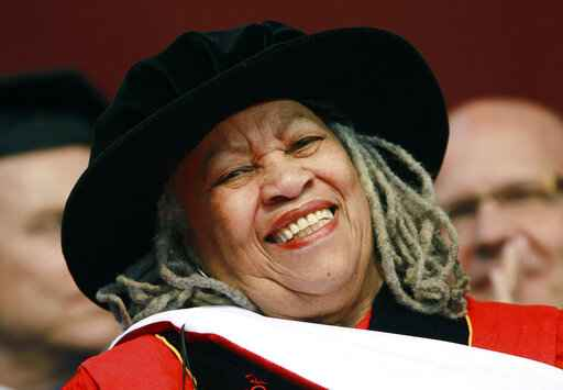 FILE - In this May 15, 2011 file photo, Pulitzer and Nobel Prize-winning author Toni Morrison smiles after delivering a speech during the Rutgers University commencement ceremony, in Piscataway, N.J. Oprah Winfrey, Ta-Nehisi Coates and Jesmyn Ward will be among the speakers at a tribute to the late Morrison. The Nobel laureate�s longtime publisher, Alfred A. Knopf, announced Tuesday, Nov. 12, 2019,  that the event will take place Nov. 21 at the Cathedral of St. John the Divine, in Manhattan. (AP Photo/Julio Cortez, File)
