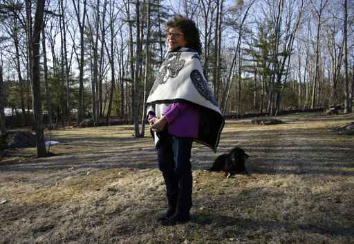 In this March 27, 2019, photo, author Shoshana Zuboff pauses while walking her dog near her home in Maine. Zuboff is the author of