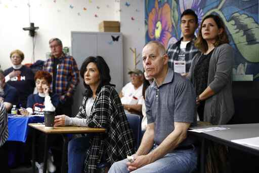 Caucus-goers listen to a precinct leader at a caucus location at Coronado High School in Henderson, Nev., Saturday, Feb. 22, 2020. (AP Photo/Patrick Semansky)