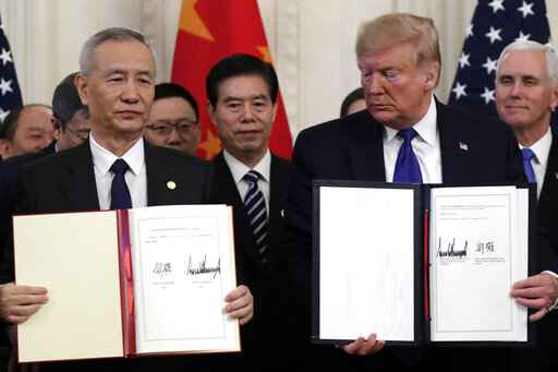 President Donald Trump holds the signed a trade agreement with Chinese Vice Premier Liu He, in the East Room of the White House, Wednesday, Jan. 15, 2020, in Washington. (AP Photo/Evan Vucci)