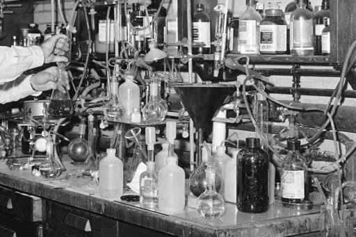 FILE - In this July 1, 1960 file photo, a chemist works in laboratory in Cambridge, Mass. For decades, scientists have used