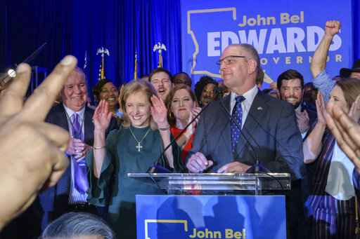 Louisiana Gov. John Bel Edwards arrives to address supporters at his election night watch party in Baton Rouge, La., Saturday, Nov. 16, 2019. On Saturday, voters reelected Edwards to a second term, as he defeated Republican businessman Eddie Rispone. (AP Photo/Matthew Hinton)