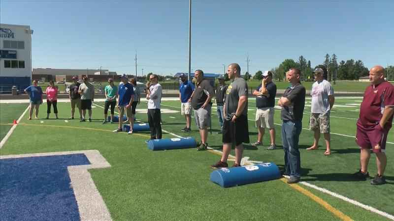 Local Football Coaches Learn How to Keep Athletes Safe on the Field