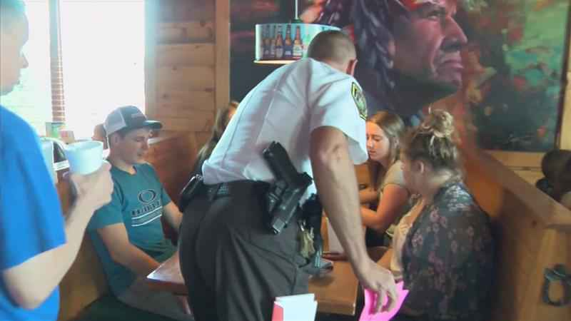 Law Enforcement, Special Olympic Athletes Team Up to Serve Lunch