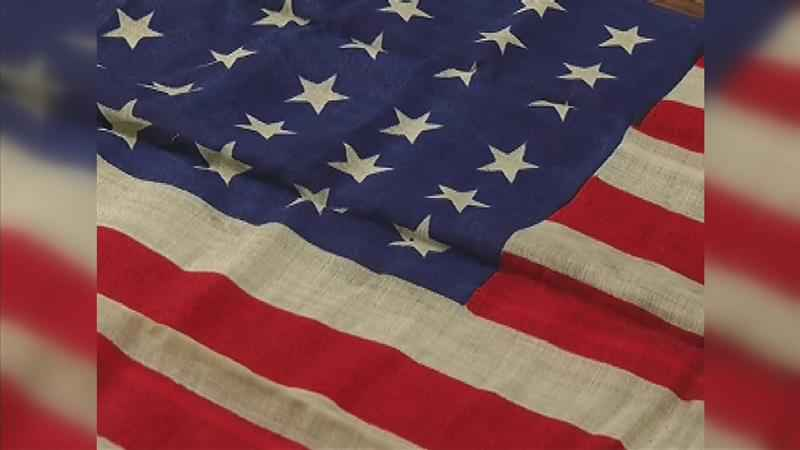 Years After Discovery, WWII Flag Hung at Austin VFW