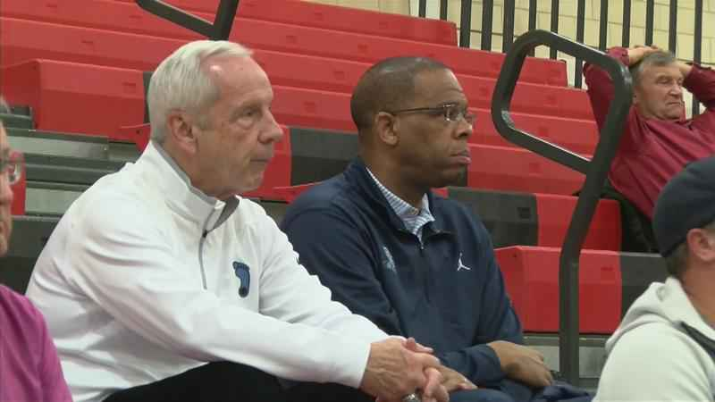 North Carolina head coach Roy Williams (pictured left) and assistant Hubert Davis (right) were in attendance at Rochester John Marshall high school on Tuesday night to watch Matthew Hurt play Red Wing.