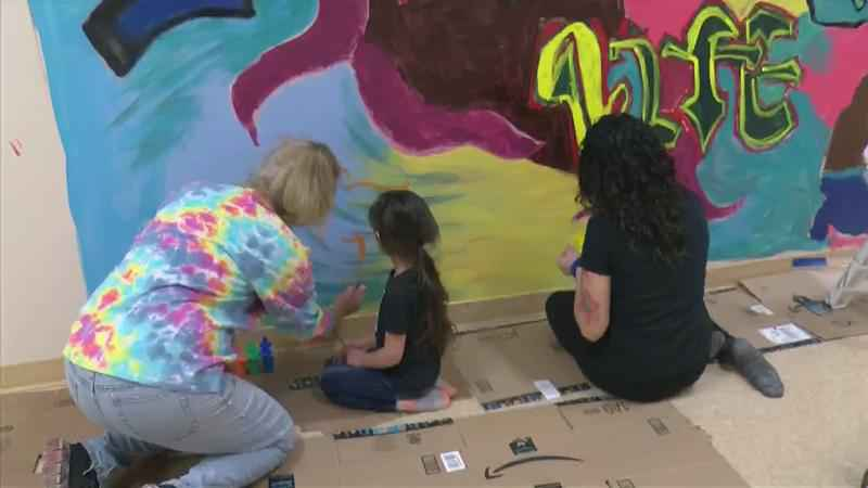 Grieving Mother Finishing Son's Mural
