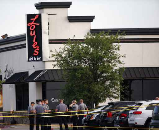 Armed customer fatally shoots gunman who fired into restaurant