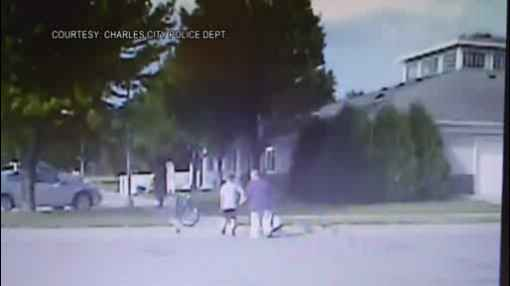 Charles City Police Dash Cam Shows Boy Helping Person Cross the Street