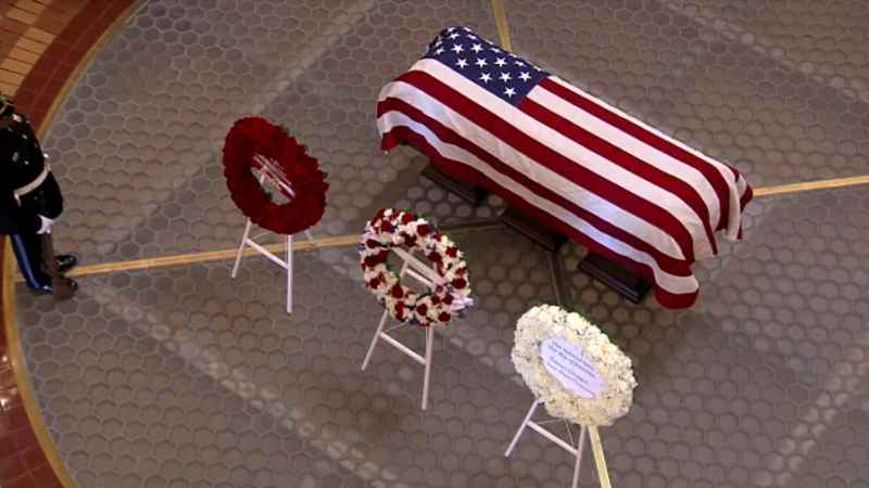 Vietnam War Refugees Place Wreaths on Ray Casket