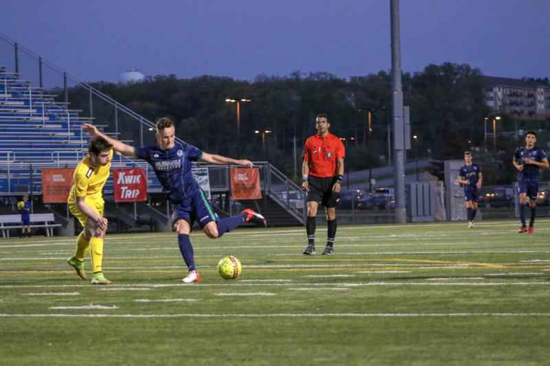 Mayhem midfielder Niklas Roessler (pictured in navy blue jersey) and the Med City FC fell one win short of a playoff berth in 2018.