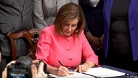 PHOTO: Nancy Pelosi (House Speaker) signs the Articles of Impeachment before being delivered by the impeachment managers to the Senate.