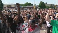Austin community members host peaceful protest